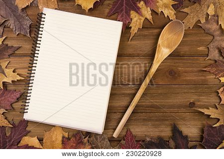 Cooking Background With Autumn Fall Leaves On Wooden Table. View From Above.