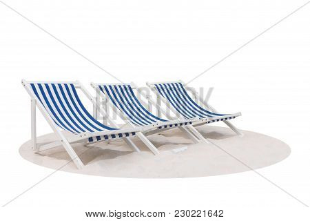 Three Blue And White Striped Beach Chair On The Sand Beach Isolated On White Background