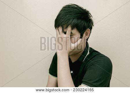Sad Man Standing Near A Wall Background