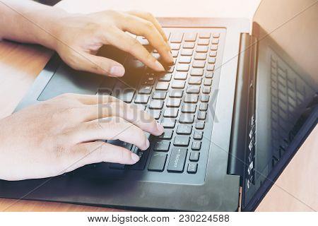 Businessman Using A Laptop At Office Desk
