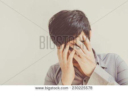 Sad Man Standing Near A Brick Wall