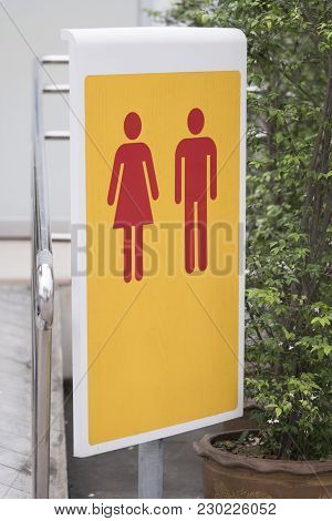 Unisex Toilet Sign - Symbol Of A Public Toilet For Male And Female
