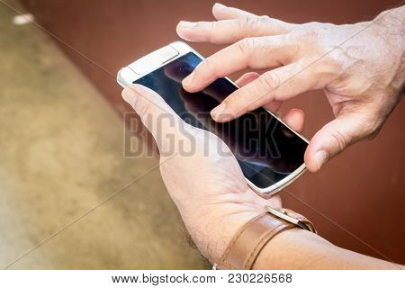 Man Hand Using A Mobile Smart Phone