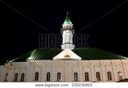 Beautiful Illuminated White Mosque With Green Roof Against The Night Sky. The Al-mardjani Mosque Bui