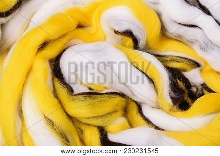 Bright Colored Merino Wool For Felting And Needlework, Hobby. The Stripes Of White, Yellow And Brown