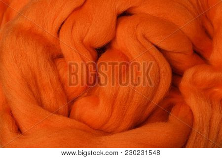 Bright Colored Merino Wool For Felting And Needlework, Hobby. The Stripes Of Orange Yarn Folded In A