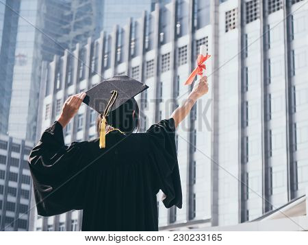 Graduation Day, Back View Of Asian Woman With Graduation Cap And Gown Holding Diploma, Successful Co