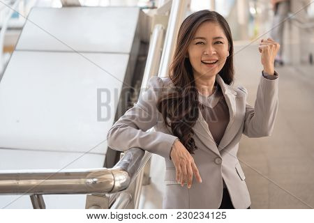 Senior Attractive Business Woman Standing With Sucessful Moment On City Street.