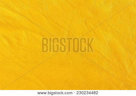Surface Leather Substitute With Creases And Wrinkles In Yellow Color, Tissue Sampling.  Background,