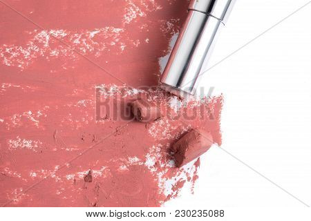 Smudged Pink Lipstick On A White Background.