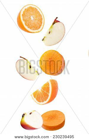 Isolated Falling Fruits. Falling Apple, Orange And Carrot Isolated On White Background With Clipping
