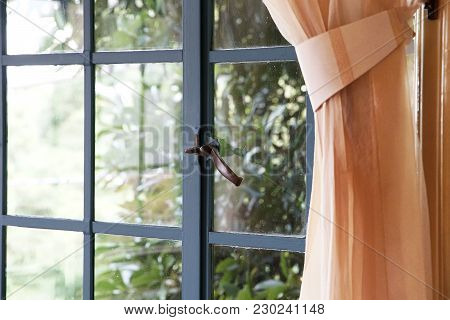 Spectacle Of Room Window And Curtain In Daytime