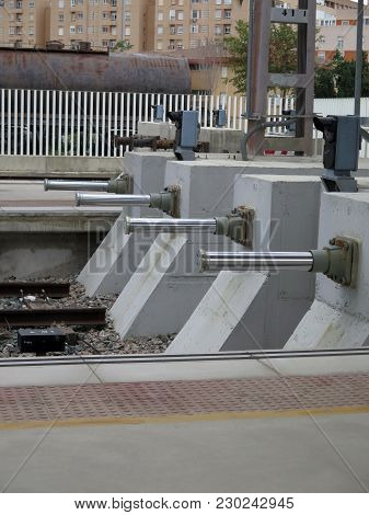 Four Concrete Buffers With Hydraulic Pistons At Almeria Railway Station, Andalusia