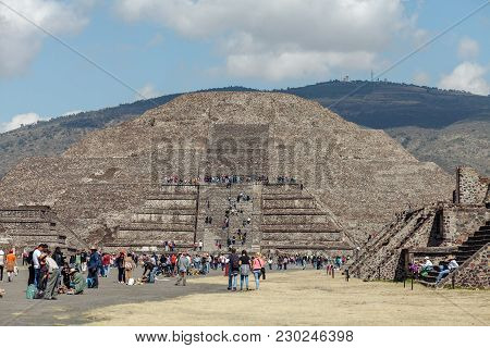 Tourists On The Road Of The Dead Against The Backdrop Of The Pyramid Of The Moon. Teotihuacan. Mexic