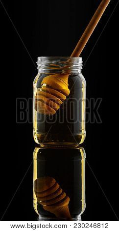 Honey Jar With Dipper And Flowing Honey