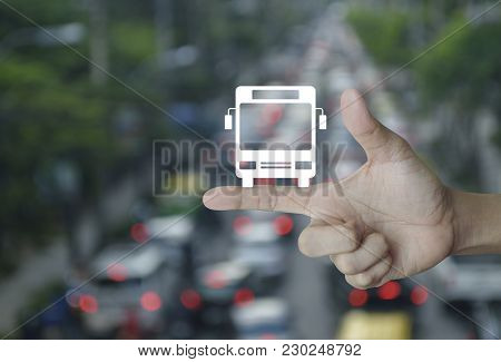 Bus Flat Icon On Finger Over Blur Of Rush Hour With Cars And Road, Business Transportation Service C