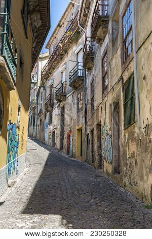 Lisbon, Portugal - July 2016: Old Narrow Street In Portuguese City In Summer Time