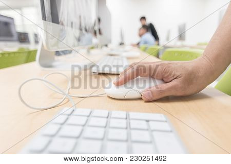 Computer Lab With Pc Desktop Computer Machine In Blurry School Class Or Office Desk Workspace With P