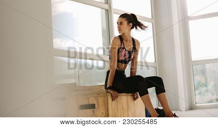 Flexible Woman In A Yoga Position At Fitness Studio. Female Doing A Split On Yoga Mat In Gym.