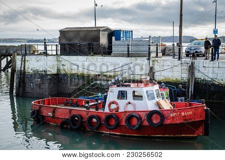 Cobh, Ireland - November 9, 2017: Red Boat Moored In The Harbour Of Cobh, A Small Irish Town Near Co