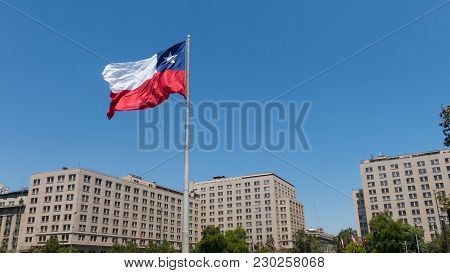 Chileans Walking Near The Giant Flag On Avenida La Alameda With The Citizenship Square, In Downtown