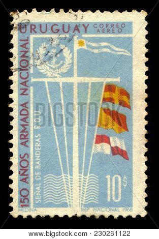 Uruguay - Circa 1968: A Stamp Printed In Uruguay Shows Signal Flags And Emblem Of Uruguay National N