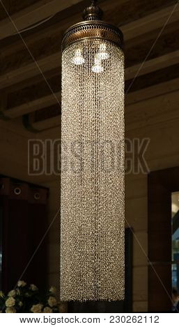 Ceiling Luminaire With Long Metal Chains In The Interior