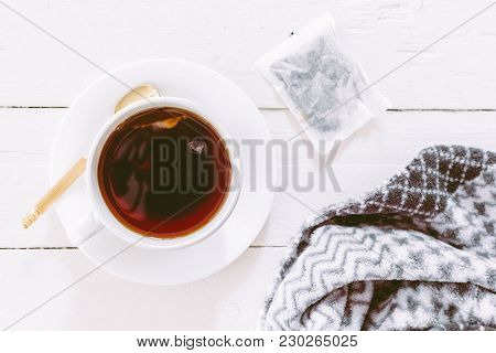 Cup Of Tea With Tea Bag On Wooden Table