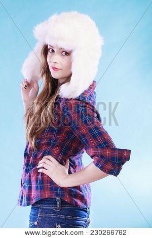 Winter Fashion. Close Up Young Woman Wearing Fashionable Wintertime Clothes White Fur Cap Studio Sho