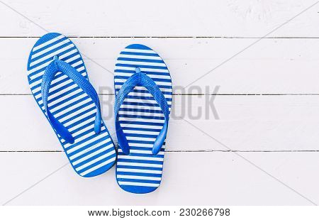 Beach Flip-flops On A Wooden Table Background