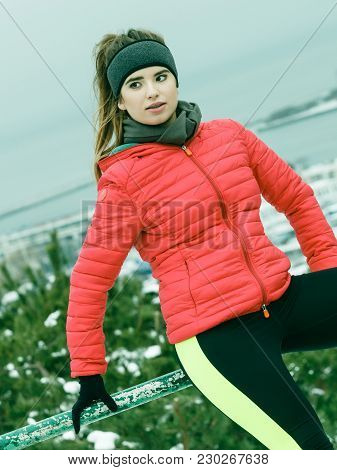 Woman Wearing Sportswear Relaxing After Exercising