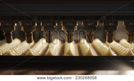 Conveyor Machine Pours Cream On Cookies. Cream On Cookies