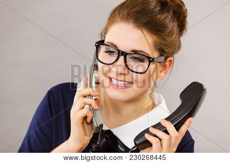 Happy Positive Business Woman Wearing Eyeglasses Smiling Sitting Working Calling Someone On Phone.