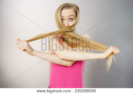Haircare And Hairstyling Concept. Woman Having Face Covered With Her Light Natural Blonde Hair.