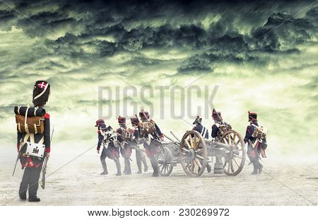 French Grenadier Watching Napoleonic Soldiers And Women Marching And Pulling A Cannon In Plain Land,