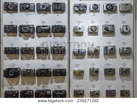 London, Uk - Mar 6, 2018: Vintage Film Cameras Lined Up On Wall In Chronological Order Starting From