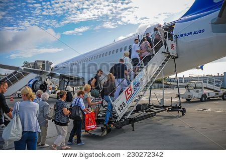 Warsaw, Poland - August 8, 2011: Passengers Get On Board Of B737-800 Boeing Plane Of Enter Air Chart