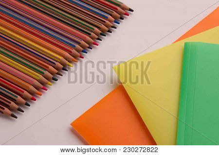 Color Pencils And Folders For Documents On The Office Table