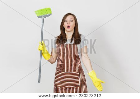 Young Shocked Housewife In Striped Apron, Yellow Gloves Isolated On White Background. Housekeeper Wo