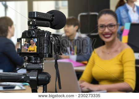 Professional Digital Mirrorless Camera With Microphone Recording Video Blog Of Businesswoman Working
