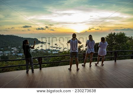 Kohtao Thailand - March 3,2018 : Unidentified Tourist Taking A Photogrpah At Sunset Viewpoint On Hig