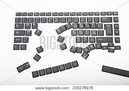 Loose Alphanumeric Covers For The Keys On A Laptop Computer Keyboard Scattered Randomly On A White S