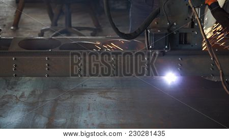Cutting Of Metal. Sparks Fly From Laser. Cut Sheet Metal At Workshop. Modern Tool In Heavy Industry.