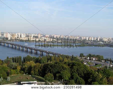 Panorama Of Kiev With Paton Bridge Across The Dnieper River. Kiev Cityscape Is Made From The Observa