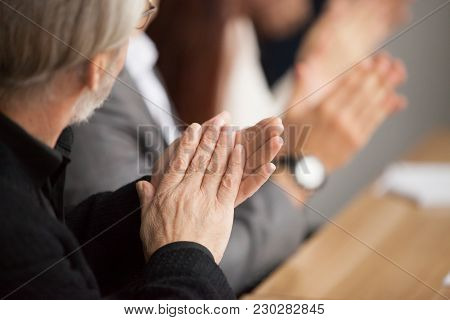 Senior Gray-haired Businessman Clapping Hands Attending Conference, Aged Training Participant Applau
