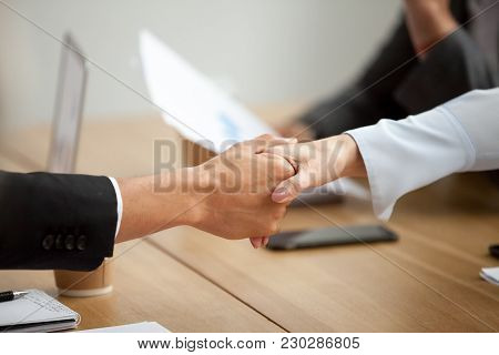 Multiracial Businessman And Businesswoman Handshaking Promising Good Deal At Meeting, African Man Sh