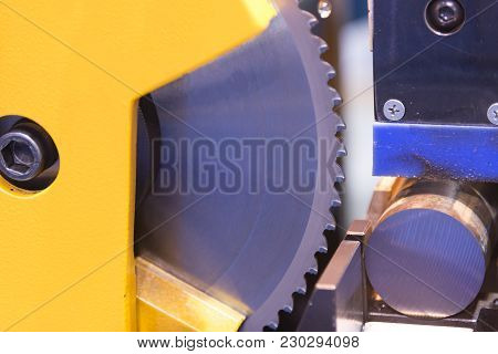 The Circular Blade Saw Machine Cutting The Metal Rod.raw Material For Manufacturing Process.