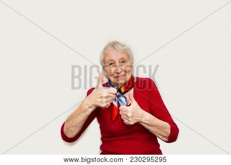 Smiling Happy Senior Woman Gesturing Perfect Sign Ok On White Studio Background. Human Emotions Conc