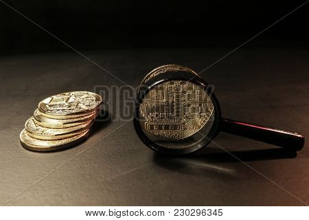 Concept Of The Ico Market Trend. Magnifying Glass And Electronic Currency Coin As A Symbol Of The St
