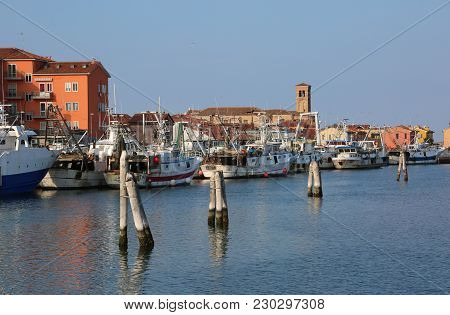 Chioggia, Ve, Italy - February 11, 2018: Large Fishing Boats Moored In The Industrial Port On The Se